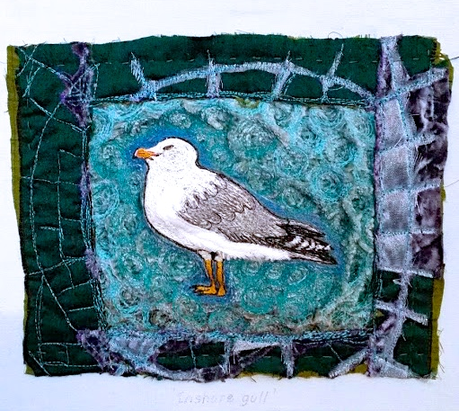 Stitched seabird interior wallpiece.