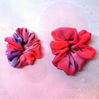 Two small silk painted hair bands.