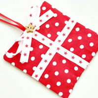 Christmas parcel gift tag in red and white polka dot