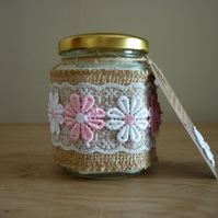 BLUEBERRY & VANILLA - SOY CANDLE - HEXAGON JAR WITH PINK AND WHITE FLOWERS.