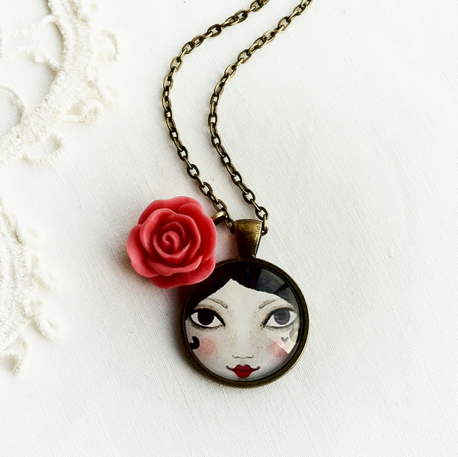 Doll Face Pendant With Pink Rose Charm