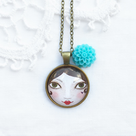 Doll Face Pendant With Turquoise Flower Charm