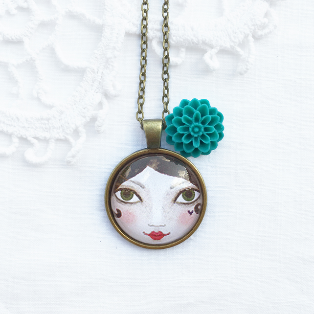 Doll Face Pendant With Cyan Flower Charm