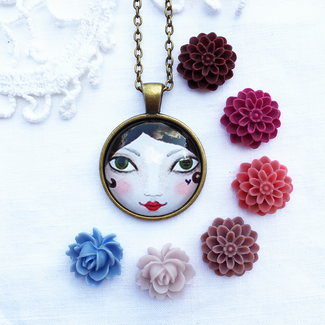 Doll Face Pendant With Flower Charm