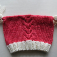Coral Baby Hat with Contrast Cream Tassels