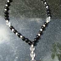 Onyx pearl and quartz heart necklace.