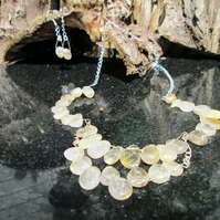 Gold rutile quartz scallpoed necklace and earrings set.