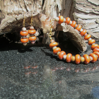 Redwood and petrified wood bracelet and earrings set.