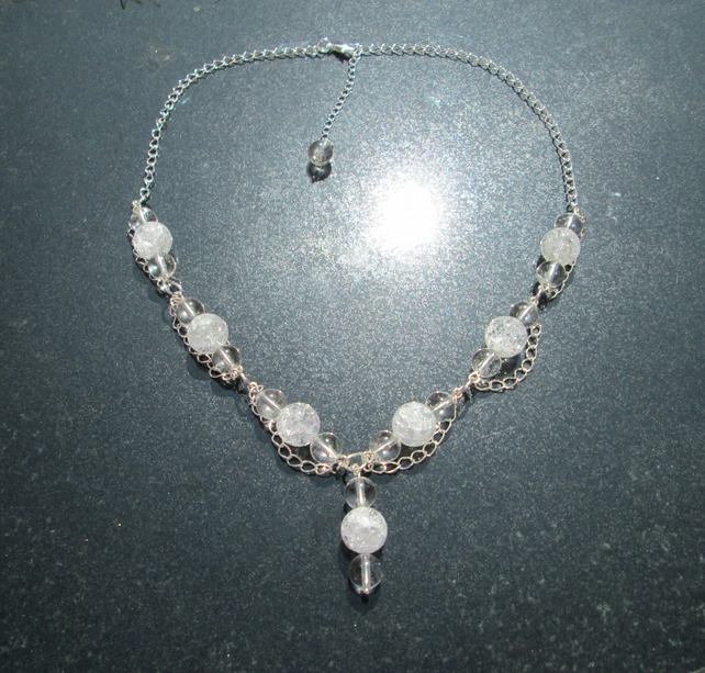 Quartz and silver chain necklace.