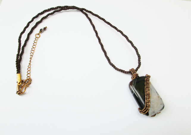 Rectangle black striped Agate wire wrapped pendant on a kumihimo braid.