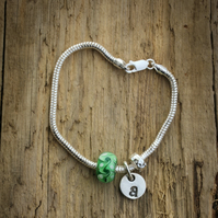 Custom recycled silver initial charm bracelet, with glass bead
