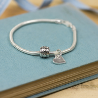 Recycled silver heart charm bracelet, with a sterling silver bead