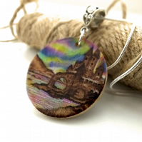 Small Wooden Pyrography Disc Pendant with Seaside Castle and Aurora Borealis