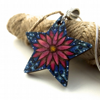 Bright pink flower star pendant with dots and swirls. Pyrography with colour.