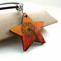 Pyrography star pendant, with a dandelion clock at sunset. Wood Necklace.