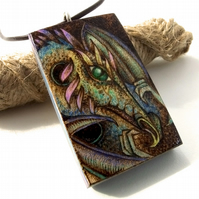 Rainbow Dragon Pyrography Pendant. Fantasy necklace in sycamore.