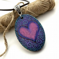 Swirled pyrography heart oval wooden pendant necklace. Hand painted and burned.
