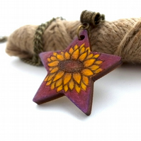 Sunflower on purple pyrography pendant. Floral star necklace.