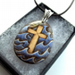 Pyrography Christian cross in a turbulent sea. Wooden teardrop necklace.