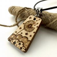 Make a wish, wooden dandelion clock pyrography pendant, with stars and clouds.