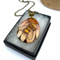 Bumblebee on a flower, hand coloured, wooden pyrography teardrop pendant.