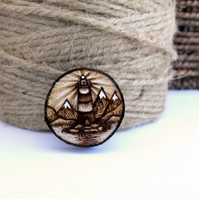 Lighthouse shining, wooden tree slice pyrography brooch. Rustic branch pin.
