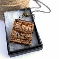 Book shaped bookshelf for bookworms. Cat and mouse pyrography pendant necklace.