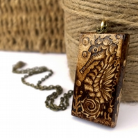 Seahorse in the deep ocean. Chunky pyrography sycamore wooden pendant.