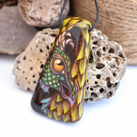 Pyrography sea dragon. Green and yellow long wooden pendant, wood gift.