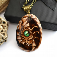 Gears and cogs dragon. Steampunk inspired wooden pyrography teardrop pendant.