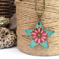 Pink flower on mint green pyrography pendant. Floral star necklace.