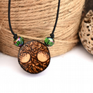 Miniature tree of life pyrography pendant. Rustic branch slice necklace.
