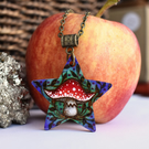 A shroom star. Pyrography toadstool pendant, fly agaric necklace.
