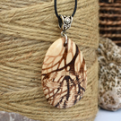Trees in reflection. Pyrography wooden teardrop pendant. Hand burned wood gift.