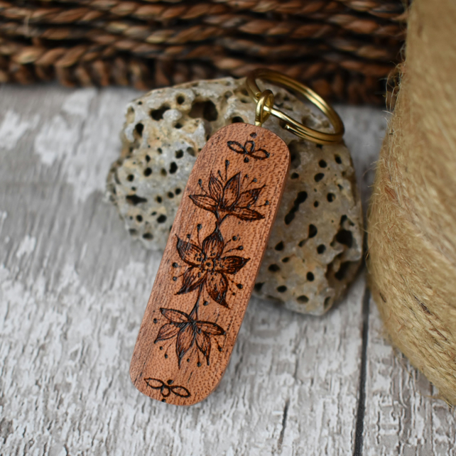 Tropical flower pyrography keyring on mahogany. Ideal wood gift, ready to post.