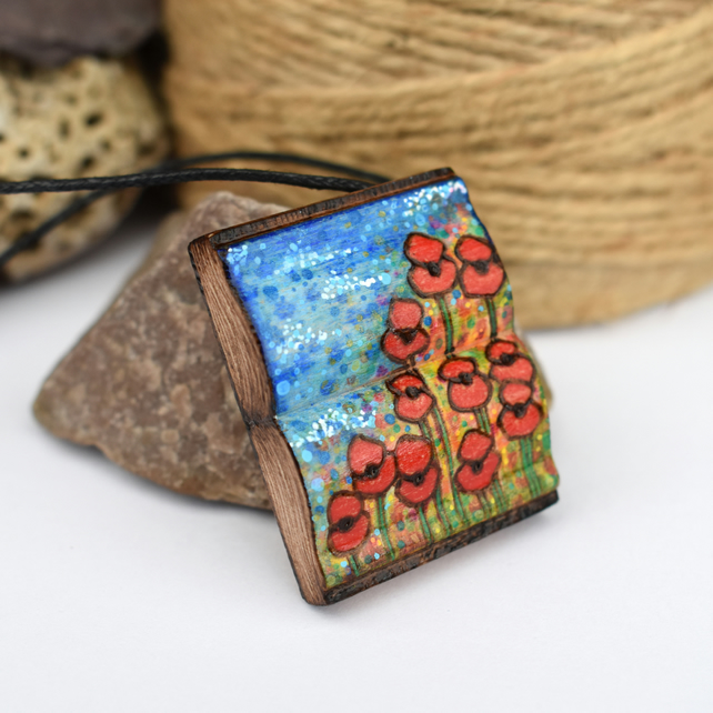 A book shaped poppy wildflower meadow pendant. Pyrography wood pendant.
