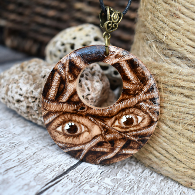 Eyes in the branches. Pyrography wooden pendant. Beautiful eyes wood gift.