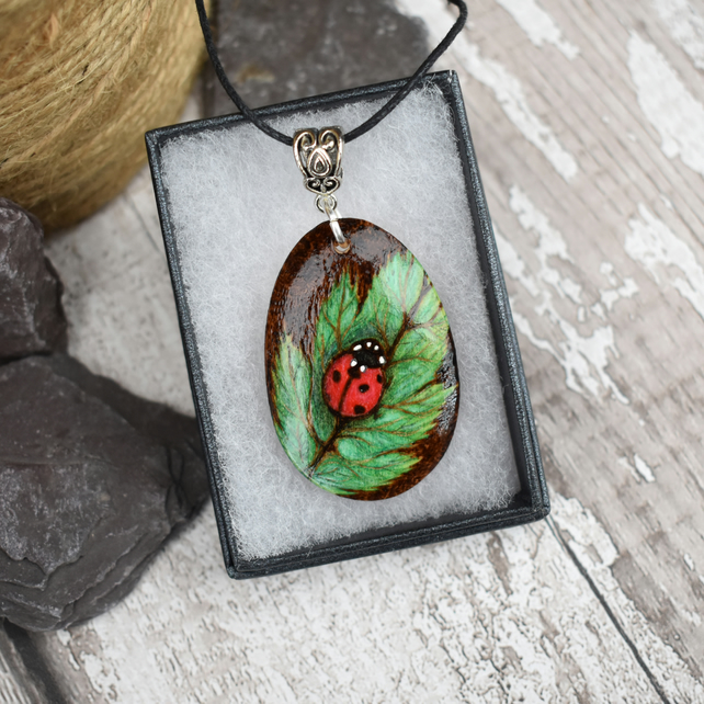 Ladybird on a leaf pyrography pendant. British wildlife gift for gardener.