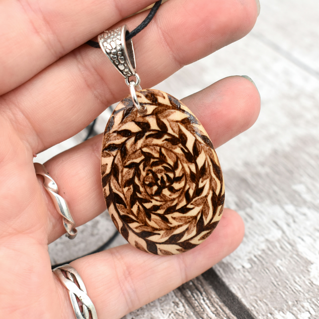 Twisted spiral tendrils. Pyrography nature inspired wooden pendant.