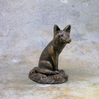 Bronze Fox sitting