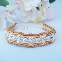 Golden beaded bracelet. Soutache braid and pearly beads.