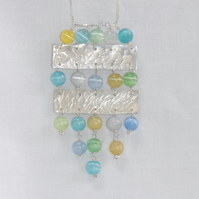 Sterling silver and blue green cat's eye glass necklace