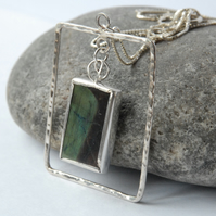 Sterling silver and spectrolite oblong frame pendant