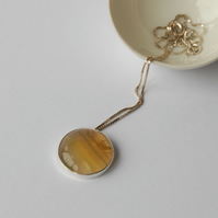 Sterling silver and golden yellow fluorite circular slider pendant