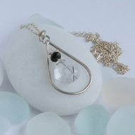 Small sterling silver and tourmalinated quartz pendant