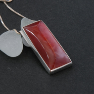 Sterling silver and strawberry red bowlerite pendant
