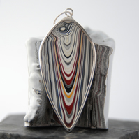 Reversible shield shaped fordite and sterling silver pendant
