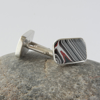 Sterling silver and early 00's fordite swivel back cufflinks