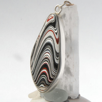 Striking sterling silver and Detroit fordite pendant