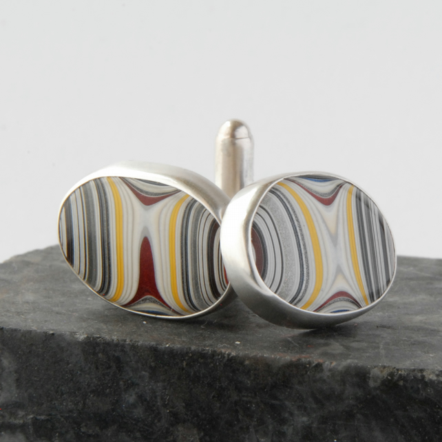 Sterling silver and 90's fordite swivel back cufflinks